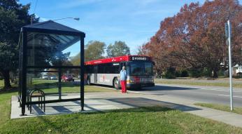 passenger taking bus